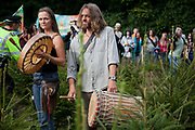 Local resident Vanessa Vine from Frack Free Sussex in a field of baby Christmas trees with fellow anti-fracking activists.  Anti-fracking activists join hands to surround the Cuadrilla fracking site. Thousands turned out for a march of solidarity against fracking in Balcombe. The village Balcombe in Sussex is the  centre of fracking by the company Cuadrilla. The march saw anti-fracking movements from the Lancashire and the North, Wales and other communities around the UK under threat of gas and oil exploration by fracking.
