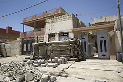 June 1, 2017 - Mosul, Iraq - The extensive detruction of West Mosul in the areas liberated from Islamic State with remains of vehicles and war debris littering the streets while the residents attemot to restart their lives. West Mosul, Iraq, 01 June 2017  (Credit Image: © Noe Falk Nielsen/NurPhoto via ZUMA Press)