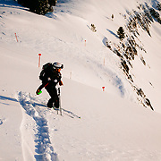 Jen Calder throwing avalanche charges in the early morning hours before JHMR opens for the day.