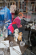 Man with Two Small Dogs in a Buggy