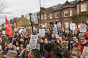 Locals fromherne Hill await for campaigners against the closure by Lambeth council of Carnegie Library in Herne Hill, south London, emerge from the premises into the street on their 10th day of occupation, 9th April 2016. The local community have been occupying their important resource for learning and social hub and after a long campaign, Lambeth have gone ahead and closed the library's doors for the last time because they say, cuts to their budget mean millions must be saved. They plan to re-purpose it into a gym although details are unknown.