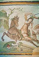 Roman mosaic of an Amazon on horseback fighting, From Daphne, a suburb of Antioch, Antakya, Turkey, 4th century AD. Marble blocks and glass paste cubes. The mosaic depicts the legendary woman warriors known as the Amazons, who fought with one breast showing, fighting a soldier with armour. inv 3463, The Louvre Museum, Paris .<br /> <br /> If you prefer to buy from our ALAMY PHOTO LIBRARY  Collection visit : https://www.alamy.com/portfolio/paul-williams-funkystock/roman-mosaic.html - Type -   Louvre    - into the LOWER SEARCH WITHIN GALLERY box. Refine search by adding background colour, place, museum etc<br /> <br /> Visit our ROMAN MOSAIC PHOTO COLLECTIONS for more photos to download  as wall art prints https://funkystock.photoshelter.com/gallery-collection/Roman-Mosaics-Art-Pictures-Images/C0000LcfNel7FpLI