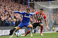 Eden Hazard of Chelsea holding the ball from Jose Fonte, the Southampton captain. Barclays Premier league match, Chelsea v Southampton at Stamford Bridge in London on Sunday 15th March 2015.<br /> pic by John Patrick Fletcher, Andrew Orchard sports photography.