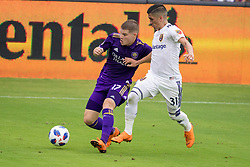 May 6, 2018 - Orlando, FL, U.S. - ORLANDO, FL - MAY 06: Orlando City forward Chris Mueller (17) and Real Salt Lake midfielder Pablo Ruiz (31) go for the ball during the soccer match between the Orlando City Lions and Real Salt Lake on May 6, 2018 at Orlando City Stadium in Orlando FL. Photo by Joe Petro/Icon Sportswire) (Credit Image: © Joe Petro/Icon SMI via ZUMA Press)