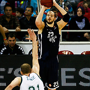 Anadolu Efes's Ermal Kurtoglu (R) during their Euroleague Top 16 game13 basketball match Anadolu Efes between Unicaja Malaga at the Abdi Ipekci Arena in Istanbul at Turkey on Thursday, March, 28, 2013. Photo by Aykut AKICI/TURKPIX