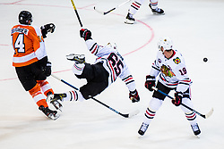 Sean Couturier of Philadelphia Flyers  and Andrew Shaw of Chicago Blackhawks during NHL game between teams Chicago Blackhawks and Philadelphia Flyers at NHL Global Series in Prague, O2 arena on 4th of October 2019, Prague, Czech Republic. Photo by Grega Valancic / Sportida
