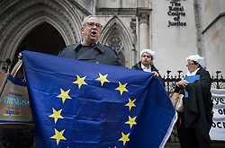 © Licensed to London News Pictures. 13/10/2016. London, UK. Pro and anti EU referendum result protestors gather outside the High Court. A legal challenge is being launched, after the EU referendum result, to force the government to seek Parliamentary approval before Brexit negotiations begin. Photo credit: Peter Macdiarmid/LNP