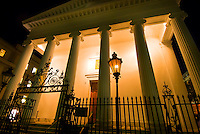 Night scene of Hibernian Hall on Meeting Street in the historic district of Charleston, South Carolina