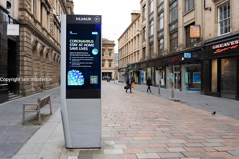 Video screen with warning message about coronavirus on Glasgow street, Scotland, UK