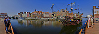 Panorama of the Pirate Galleon Ferry and the Old Town in Gadansk. In camera panorama taken with a Fuji XT1 camera and Zeiss 12 mm f/2.8 lens (ISO 200, 12 mm, f/16, 1/180 sec). JPG processed with Capture One Pro, Focus Magic, and Photoshop CC.