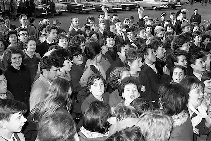 The Beatles arrive in Ireland to play their only gig in the country in the Adelphi Cinema on 7 November 1963.  Dubliners clamour to see the band on their arrival at the Gresham Hotel..07.11.1963