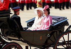 Prince Harry, The Duchess of Cornwall and the Duchess of Cambridge arrive for the Trooping the Colour ceremony at Horse Guards Parade, central London, as the Queen celebrates her official birthday.