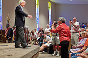 Aug, 25, 2009 -- SUN CITY, AZ: SEN JOHN MCCAIN talks to a constituent during the Town Hall meeting on health care sponsored by Sen John McCain at Grace Bible Church in Sun City, AZ, Tuesday. More than 1,000 people attended the meeting in the church, which seats 700. Sun City is a staunchly Republican suburb of Phoenix and most of the crowd was opposed to President Obama health care reform efforts.    Photo by Jack Kurtz