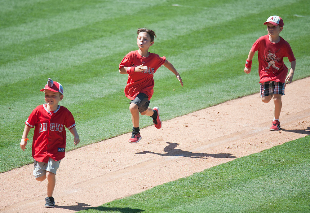 Kids run the bases after the Angels' 8-1 victory over the Chicago White Sox at Angel Stadium on Sunday.<br /> <br /> ///ADDITIONAL INFO:   <br /> <br /> angels.0718.kjs  ---  Photo by KEVIN SULLIVAN / Orange County Register  -- 7/17/16<br /> <br /> The Los Angeles Angels take on the Chicago White Sox at Angel Stadium.