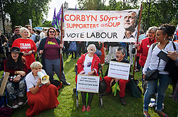 """© Licensed to London News Pictures. 27/06/2016. London, UK. Supporters of Labour Party leader Jeremy Corbyn take part in a  """"Keep Corbyn"""" Momentum demonstration outside the Houses of Parliament in London. The majority of the Labour shadow cabinet resigned today (Mon) in protest at Corbyn's leadership. Photo credit: Ben Cawthra/LNP"""