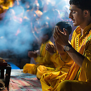 The faithful perform aarti, a puja to the Ganges, at the Parmarth Niketan Ashram in Rishikesh, India.