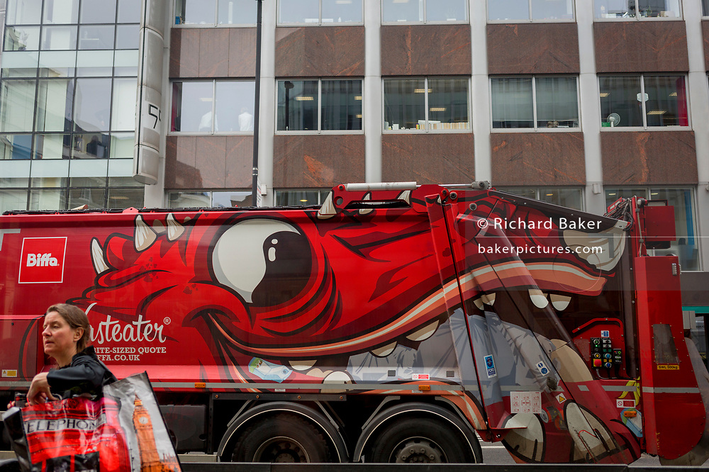 The day after Facebook's Mark Zuckerberg faced Senate Committee questions in Washington, a large eye on the side of a refuse lorry passes the offices of Cambridge Analytica on New Oxford Street, the UK company accused of harvesting the personal details of Facebook users (including Zuckerberg himself) in its data privacy scandal, on 11th April, 2018, in London, England.