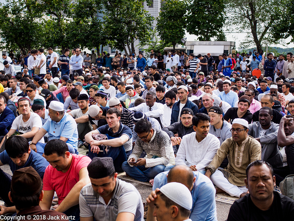 15 JUNE 2018 - SEOUL, SOUTH KOREA: Men at Seoul Central Mosque on Eid al Fitr, the Muslim Holy Day that marks the end of the Holy Month of Ramadan. There are fewer than 100,000 Korean Muslims, but there is a large community of Muslim immigrants in South Korea, most in Seoul. Thousands of people attend Eid services at Seoul Central Mosque, the largest mosque in South Korea.   PHOTO BY JACK KURTZ