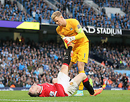 Joe Hart of Manchester City helps out with Wayne Rooney of Manchester United cramp - Barclays Premier League - Manchester City vs Manchester Utd - Etihad Stadium - Manchester - England - 2nd November 2014  - Picture David Klein/Sportimage