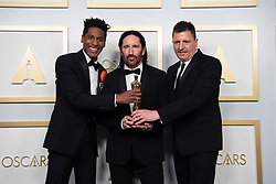 Jon Batiste, Trent Reznor, and Atticus Ross accept the Oscar® for Original Score during the live ABC Telecast of The 93rd Oscars® at Union Station in Los Angeles, CA, USA on Sunday, April 25, 2021. Photo by Matt Petit/A.M.P.A.S. via ABACAPRESS.COM