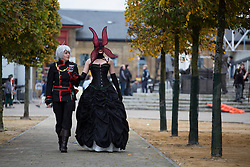 © licensed to London News Pictures. London, UK 28/10/2012. Siobhan MacLurg (L) cosplaying as Allen Walker and Mags Stocks cosplaying as Grave of Maria outside ExCeL, London as people visit MCM Expo. Photo credit: Tolga Akmen/LNP