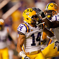 Sep 25, 2010; Baton Rouge, LA, USA; LSU Tigers cornerback Tyrann Mathieu (14) celebrates with teammate LSU Tigers cornerback Morris Claiborne (17) after picking up a fumble against the West Virginia Mountaineers during the first half at Tiger Stadium.  Mandatory Credit: Derick E. Hingle