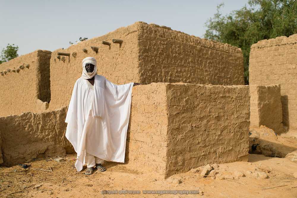 Rakumi Rua, 68, beside the low wall of a latrine he built in his family compound in the village of Gadirga in the Commune of Soukoukoutan in the Dosso Region of Niger on 23 July 2013. Under a WaterAid Community-Led Total Sanitation (CLTS) program, the cost of cement covers for such latrines is subsidized, reducing the cost to the owner from CFA 5000 to CFA 3000. Rua says that through the program he learned that open defecation brings the risk of disease, and says that he now feels safer.