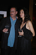 Jean Reno and Zofia Borucka. 4 Inches, A  Photographic Auction in aid of the Elton John Aids Foundation hosted by Tamara Mellon and Arnaud Bamberger. Christie's. 8 King St. London. 25 May 2005. ONE TIME USE ONLY - DO NOT ARCHIVE  © Copyright Photograph by Dafydd Jones 66 Stockwell Park Rd. London SW9 0DA Tel 020 7733 0108 www.dafjones.com