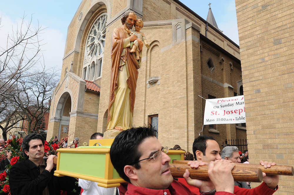 Parishioners at Our Lady of Pompeii Catholic Church in Chicago's Tri-Taylor lead a statue of St. Joseph from the church to a gathering hall for the celebration of St. Joseph's Bountiful Table. The annual Italian feast commemorates the end of drought and famine following the prayers of hungry Sicilians to Saint Joseph the Protector.