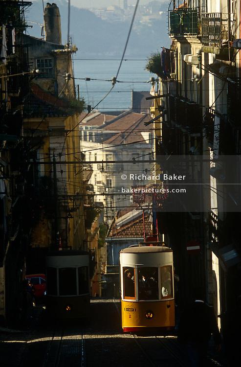 A city tram climbs the steep countours of Lisbon's Rua de Bica de Quarte Belo in the Portuguese capital's Bica district.