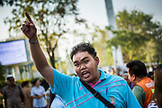"""01 FEBRUARY 2014 - BANGKOK, THAILAND: A Thai man screams at anti-government protestors blocking his access to the polls. He wanted to vote and was upset when protestors shut his polling place. Thais went to the polls in a """"snap election"""" Sunday called in December after Prime Minister Yingluck Shinawatra dissolved the parliament in the face of large anti-government protests in Bangkok. The anti-government opposition, led by the People's Democratic Reform Committee (PDRC), called for a boycott of the election and threatened to disrupt voting. Many polling places in Bangkok were closed by protestors who blocked access to the polls or distribution of ballots. The result of the election are likely to be contested in the Thai Constitutional Court and may be invalidated because there won't be quorum in the Thai parliament.    PHOTO BY JACK KURTZ"""