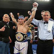 KISSIMMEE, FL - MARCH 06:  Jonathan Oquendo celebrates his victory against Gabino Cota for the WBO Latino Flyweight Title belt during the Telemundo Boxeo boxing match at the Kissimmee Civic Center on March 6, 2015 in Kissimmee, Florida. Oquendo won the belt after a 10 round unanimous decision on the scorecards. (Photo by Alex Menendez/Getty Images) *** Local Caption *** Jonathan Oquendo; Gabino Cota