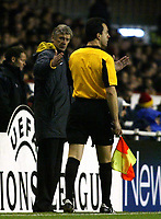 Photo: Chris Ratcliffe.<br />Arsenal v Ajax. UEFA Champions League. 07/12/2005.<br />Arsene Wenger tells the linesman by how much Henry missed his penalty