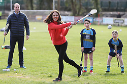 The Duchess of Cambridge tries out hurling during a visit to a local Gaelic Athletic Association (GAA) club to learn more about traditional sports during the third day of their visit to the Republic of Ireland.