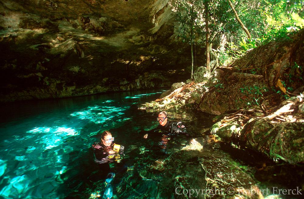 MEXICO, YUCATAN, TOURISM scuba divers at 'Dos Ojos Cenote'