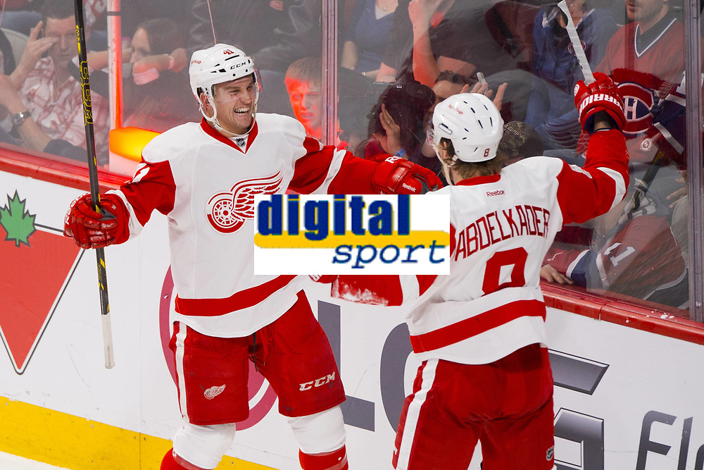 05 April 2014: Luke Glendening 41 of the Detroit Red Wings celebrates his goal with teammate Justin Abdelkader 8 during the NHL Eishockey Herren USA match against the Montreal Canadiens at the Bell Centre in Montreal Quebec, Canada. The Canadiens defeat the Red Wings 5-3. NHL Eishockey Herren USA APR 05 Red Wings at Canadiens <br /> Norway only