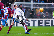 Jordy Hiwula of Coventry City (11) helps the ball on under pressure from Rory McArdle of Scunthorpe United (23) during the EFL Sky Bet League 1 match between Scunthorpe United and Coventry City at Glanford Park, Scunthorpe, England on 5 January 2019.
