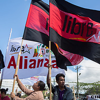 Protestors against Juan Orlando Hernández waved flags during a demonstration.