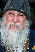 Portrait of old man with long beard smiling.