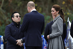 The Duke and Duchess of of Cambridge speaks with Aiyawatt Srivaddhanaprabha as they arrive at Leicester City Football ClubÕs King Power Stadium, during a visit to Leicester to pay tribute to those who were killed in the helicopter crash last month.