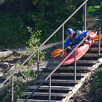 David Mannning launches his kayak down stairs into the Kananaskis River in the Canadian Rockies near Calgary, Alberta.