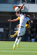 Mansfield's Mitchell Rose (front) challenges Newport's Mark Randall. Skybet EFL league two match, Newport county v Mansfield Town at Rodney Parade in Newport, South Wales on Saturday 6th August 2016.<br /> pic by Carl Robertson, Andrew Orchard sports photography.