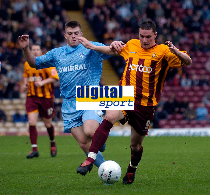 Photo: Jed Wee.<br />Bradford City v Tranmere Rovers. The FA Cup.<br />06/11/2005.<br /><br />Bradford's Andy Cooke (R) and Tranmere's Steven Jennings challenge for possession.