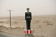 A fake policeman reminds motorists to reduce their speed on a highway in China's western Xinjiang Province. The World Health Organization.estimates that more than 600 lives are lost and more than 45,000 people are.injured on China's roads every day. In China, injuries from road traffic crashes are the leading cause of.death for people 15 to 45 years old.  .