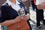 Demonstration against the planned US military radar base in Czech Republic on the day of Barack Obamas arrivel to Prague. Woman with a flyer invitation for a second demonstration which took place at Wenceslas Square on Sunday - the day of the EU-US summit in Prague.