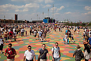 London, UK. Thursday 9th August 2012. London 2012 Olympic Games Park in Stratford. Crowds of people on the coloured walkway which is soft and child friendly. Both kids and adults find themselves walking on specific colours.