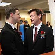 Partners Kevin Foster (right) and Joey Thibodeaux recite their vows during their same sex wedding ceremony, just after midnight, when Florida's ban on same-sex marriage ended, at the Osceola County Courthouse in Kissimmee, Florida on Tuesday, January 6, 2014.  (AP Photo/Alex Menendez)