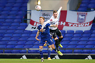 Portsmouth midfielder Ronan Curtis (11) battles with Ipswich Town midfielder Jon Nolan (11) during the The FA Cup match between Ipswich Town and Portsmouth at Portman Road, Ipswich, England on 7 November 2020.