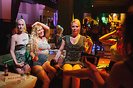Women sit on stage at the afterparty of the Trans Beauty Pageant held at The Mekan, central Istanbul, Turkey.