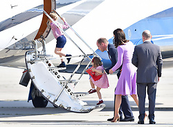 The Duke and Duchess of Cambridge as they board a plane in Hamburg with Prince George and Princess Charlotte at the end of their visit to Germany.